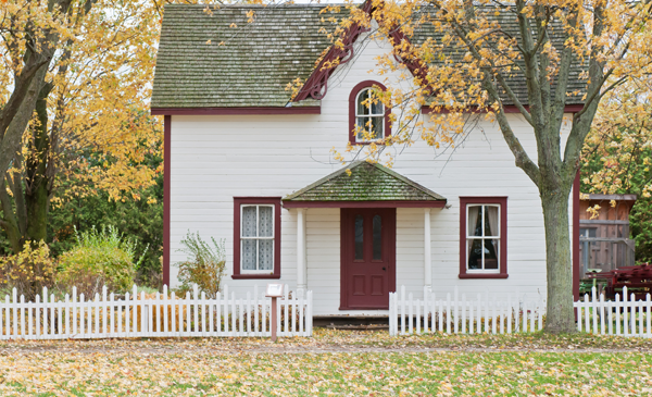 White home, red trim in fall